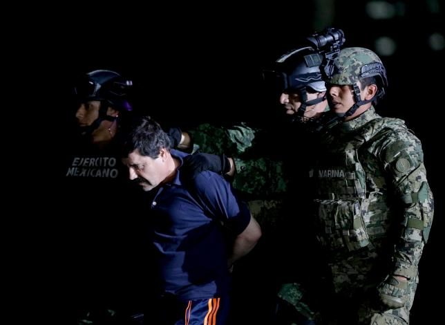 "Recaptured drug lord Joaquin ""El Chapo"" Guzman is escorted by soldiers in Mexico City"