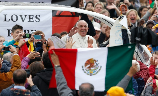 Pope Francis passes Mexico's flag as he arrives to lead general audience in St. Peter's Square at Vatican