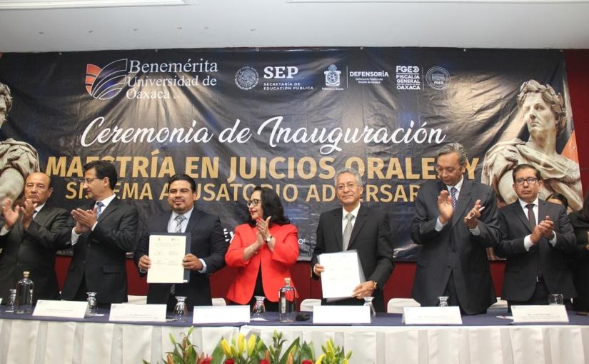 PJE Y BUO firman convenio académico decolaboración